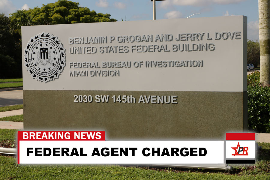 FEDERAL AGENT CHARGED