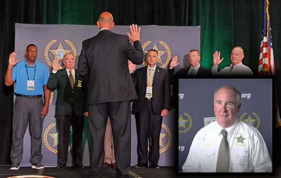 Sheriff Staly (right) being sworn in as an FSA Director. Photo Flagler County Sheriff's Office.