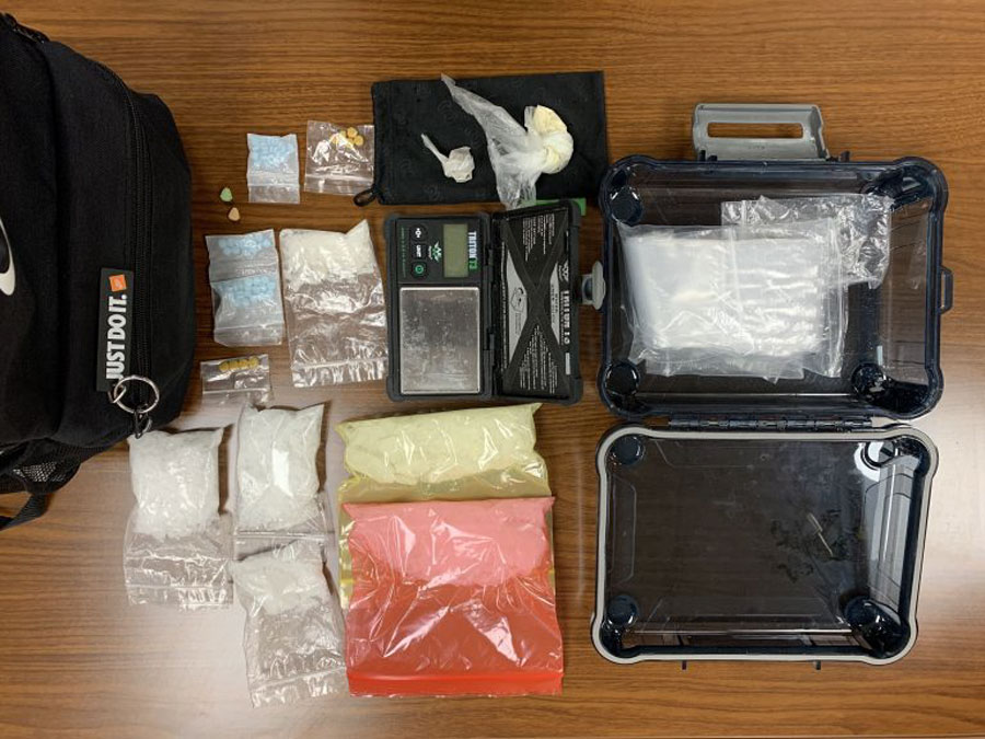 Inside the large portion of the backpack there was a transparent, navy waterproof container holding 5 additional baggies with a total weight of 376.8 grams of Methamphetamine.