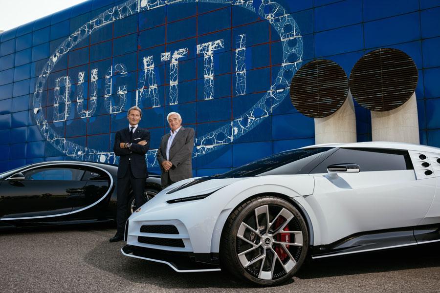Two Bugatti eras, two Bugatti presidents: Romano Artioli and Stephan Winkelmann in front of the Fabbrica Blu.