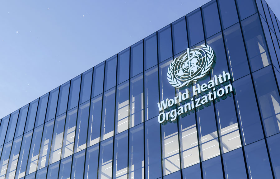 World Health Organization Signage Logo on Top of Glass Building. Workplace in High-rise Office Headquarter at Night Time. June 15, 2020. Editorial credit: askarim / Shutterstock.com, licensed.