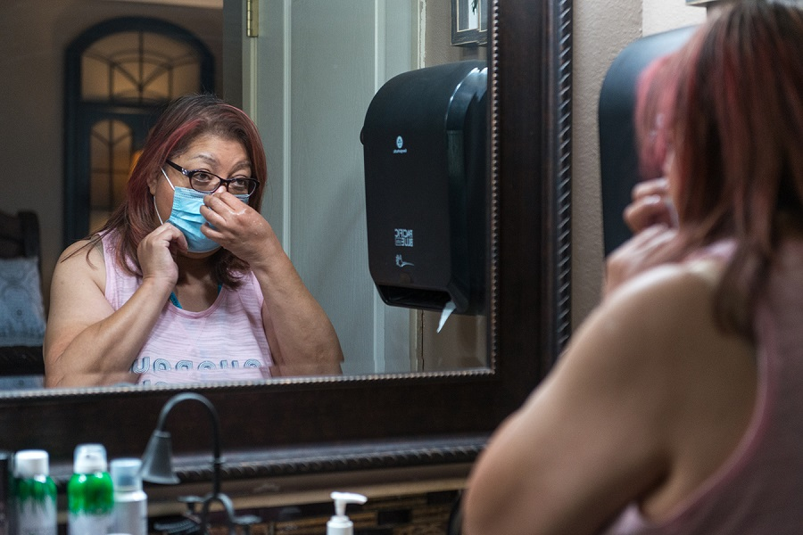 Duenas starts her home dialysis routine around 8 p.m. She must maintain a sterile environment and uses masks and gloves. Her husband, Jose, installed an automatic paper towel dispenser in their bathroom to help ensure proper hygiene.