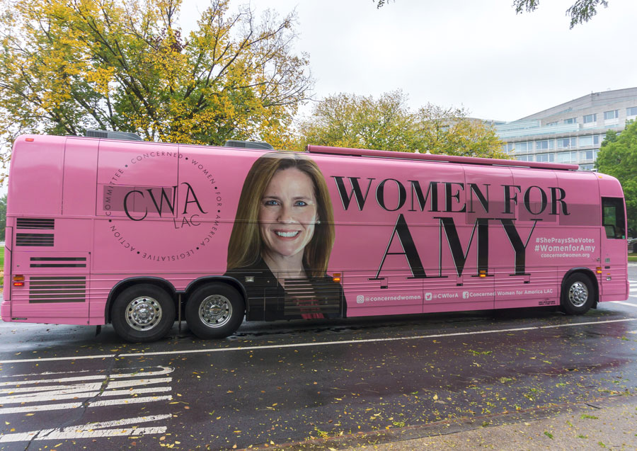 On the first day of hearings for Supreme Court nominee Amy Coney Barrett, supporters arrived in a special pink bus. Washington, D.C. - October 12, 2020. Editorial credit: Erik Cox Photography / Shutterstock.com, licensed.