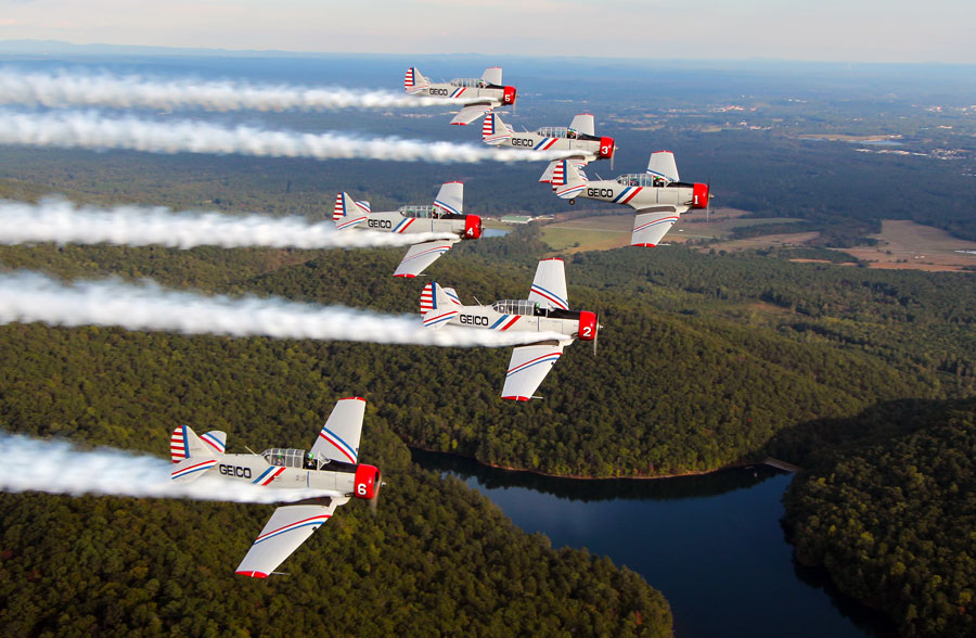 """The six WWII-era aircraft will perform a dynamic 18-minute, low-level precision-flying demonstration.  The year marks the 75th Anniversary of the end of WWII and the GEICO Skytypers vintage airplanes trained the """"greatest generation"""" of pilots for WWII."""