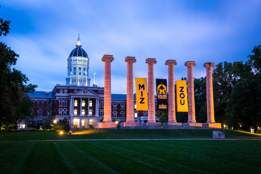 Mizzou's historic columns, with Jesse Hall in the background, on the campus of the University of Missouri in Columia. Columbia, MO - October 10, 2019. Editorial credit: Kristopher Kettner / Shutterstock.com, licensed.