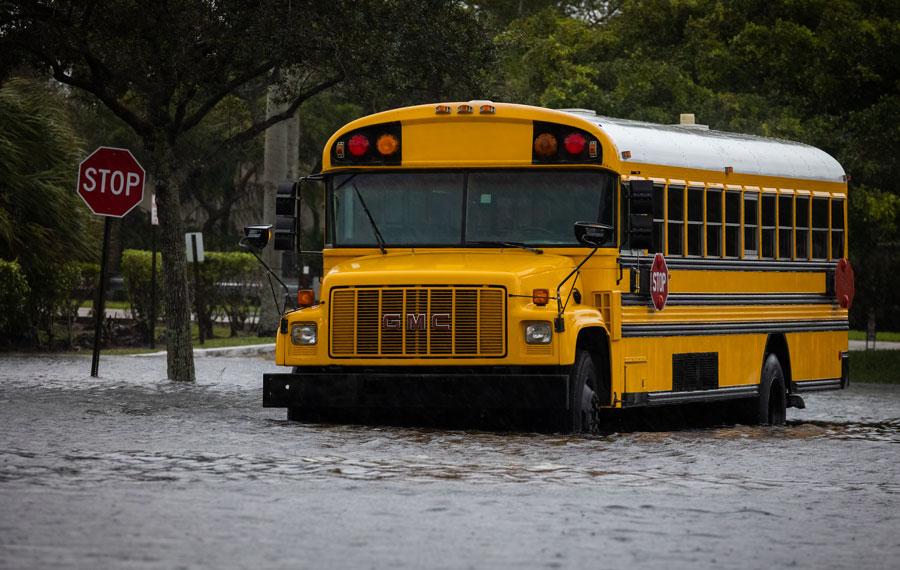 School Buses stuck in water during Hurricane Eta at Florida. Street Flood. Coral Springs, Florida. November 08, 2020. Editorial credit: YES Market Media / Shutterstock.com, licensed.