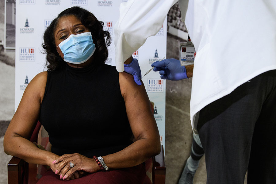 Anita Jenkins, CEO of Howard University Hospital, receives the COVID-19 vaccine at the hospital on Dec. 15. Photo Credit: Nicholas Kamm, AFP, Getty Images.