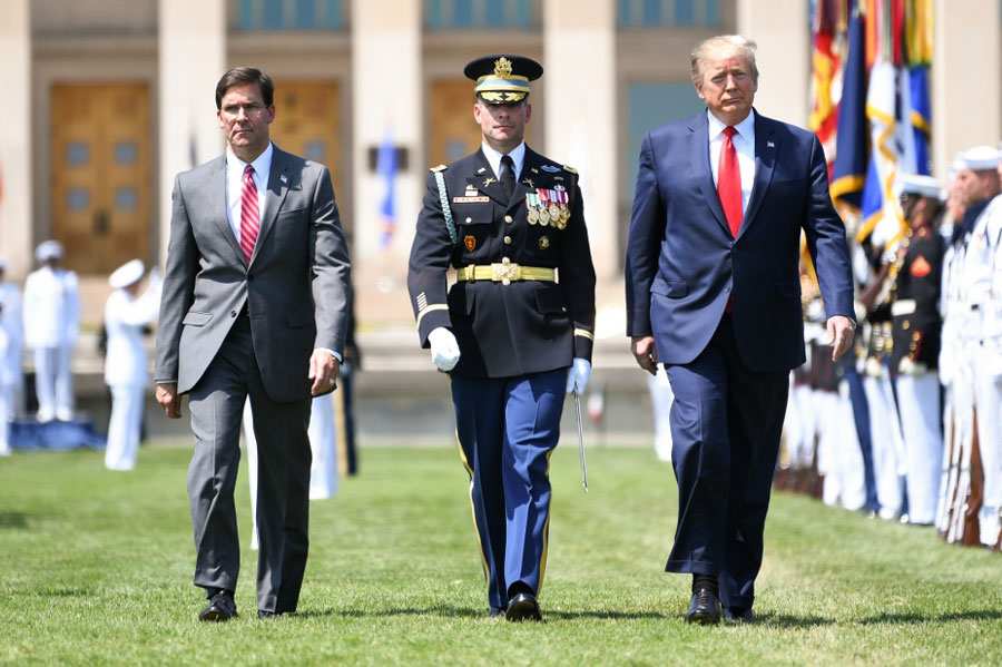 President Trump, U.S. Secretary of Defense Mark T. Esper and 3rd U.S. Infantry Regiment Commander Col. James J. Tuite inspect the troops during a Full Honors Welcome Ceremony at the Pentagon's River Terrace Parade Field in Arlington, Va., July 25, 2019. U.S. Army photo by Laura Buchta. The appearance of U.S. Department of Defense (DoD) visual information does not imply or constitute DoD endorsement.