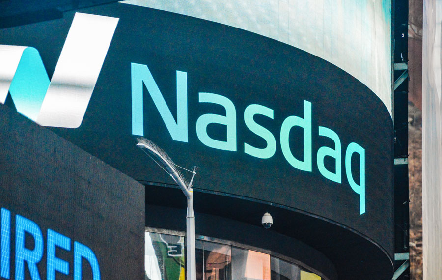 A Nasdaq headquarters on Times Square, New York City. Market Site is epicenter for Nasdaq and it is located on New York City`s Times Square. New York City, May 27 2017, Editorial credit: Goran Vrhovac / Shutterstock.com, licensed.