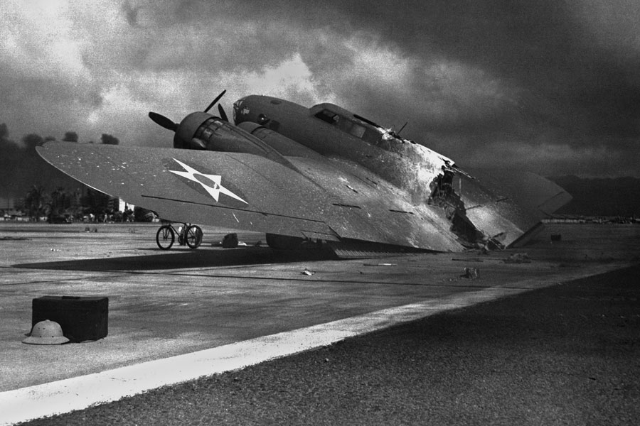 Ruins of a B-17C aircraft rests near at Hickam Field after the Japanese attack on Pearl Harbor, Dec. 7, 1941. Nearly half of the approx. 60 airplanes at Hickam Field had been destroyed or damaged. Photo credit ShutterStock.com, licensed.