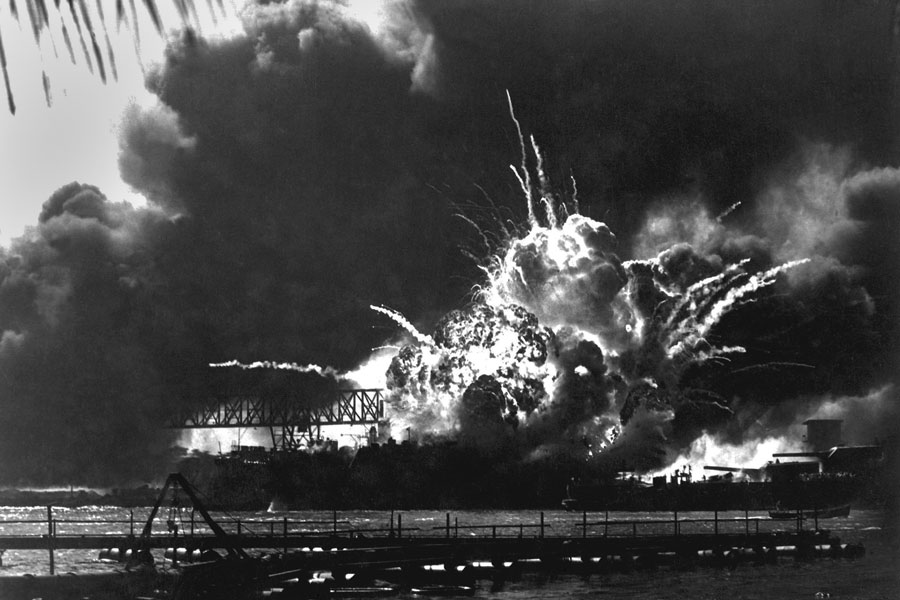 Explosion of the USS Shaw's forward magazine during the Japanese attack on Pearl Harbor, Dec. 7, 1941. The Shaw was repaired and served in the Pacific through World War II. Photo credit ShutterStock.com, licensed.