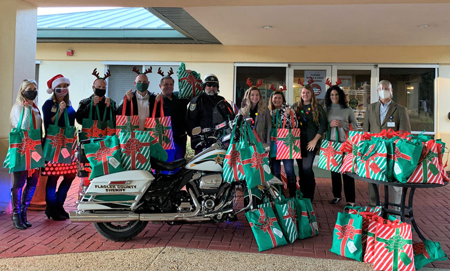 Members of Granny Nannies, FCSO, and other organizations dropping off the gift bags to Grand Oaks.