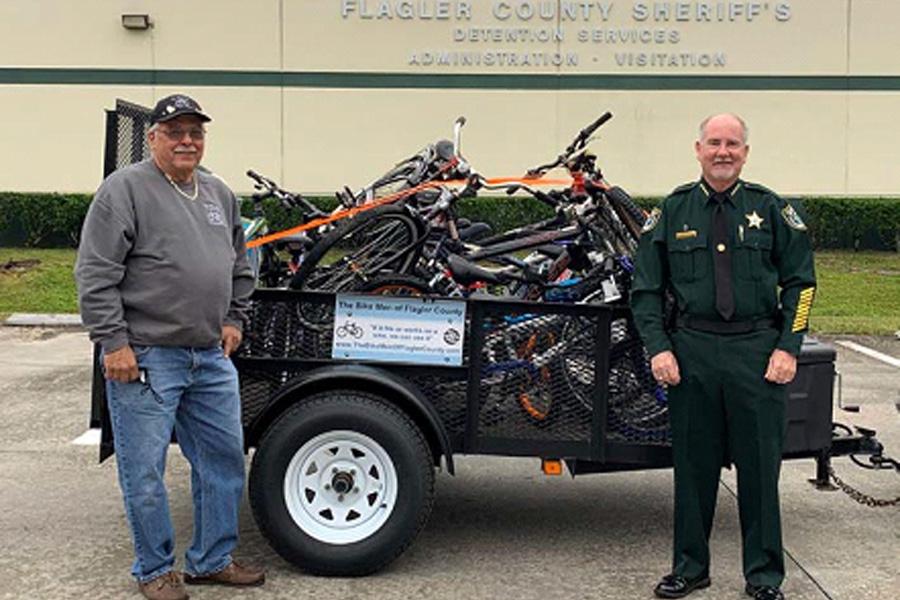 Joe Golan, Founder of the Bike Men of Flagler County, with Flagler County Sheriff Staly.