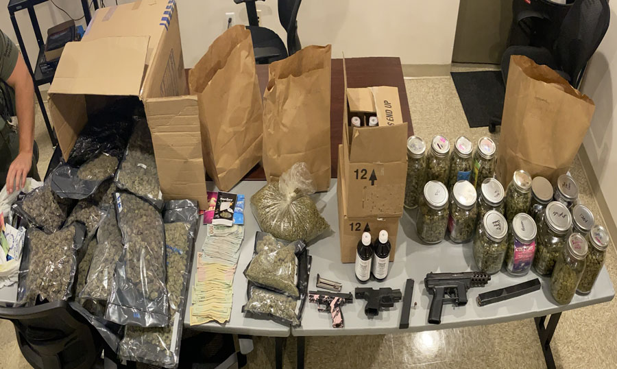 The narcotics investigation resulted in three semi-automatic loaded firearms with ammunition being seized, 21.4 pounds of cannabis packaged for sale and 24 full bottles of promethazine syrup. This syrup is a schedule five controlled substance also known as Lean, Mudd or Sizzurp, $9,960 in illicit money being confiscated.
