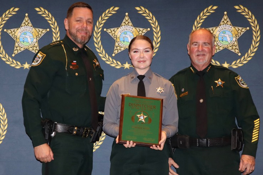 From left to right: FSA President and Gilchrist County Sheriff Bobby Schultz, FCSO Communications Specialist McKenzie Davis, and Sheriff Rick Staly.