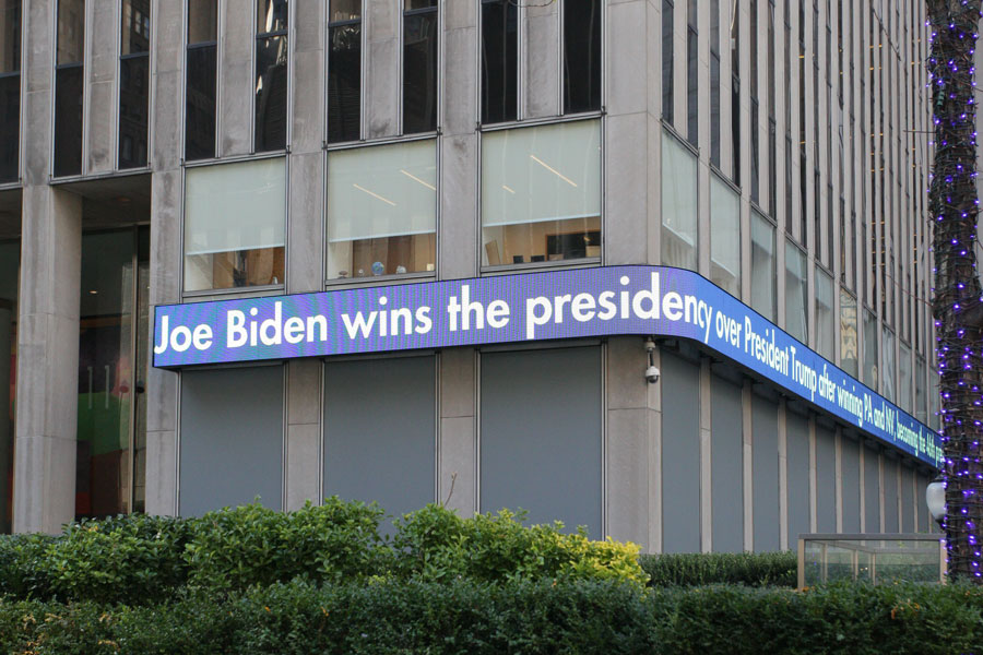 The Fox News ticker outside the News Corp buil ding announces its projection that Joe Biden has defeated Donald Trump in the 2020 presidential election. New York City, New York - November 7, 2020.