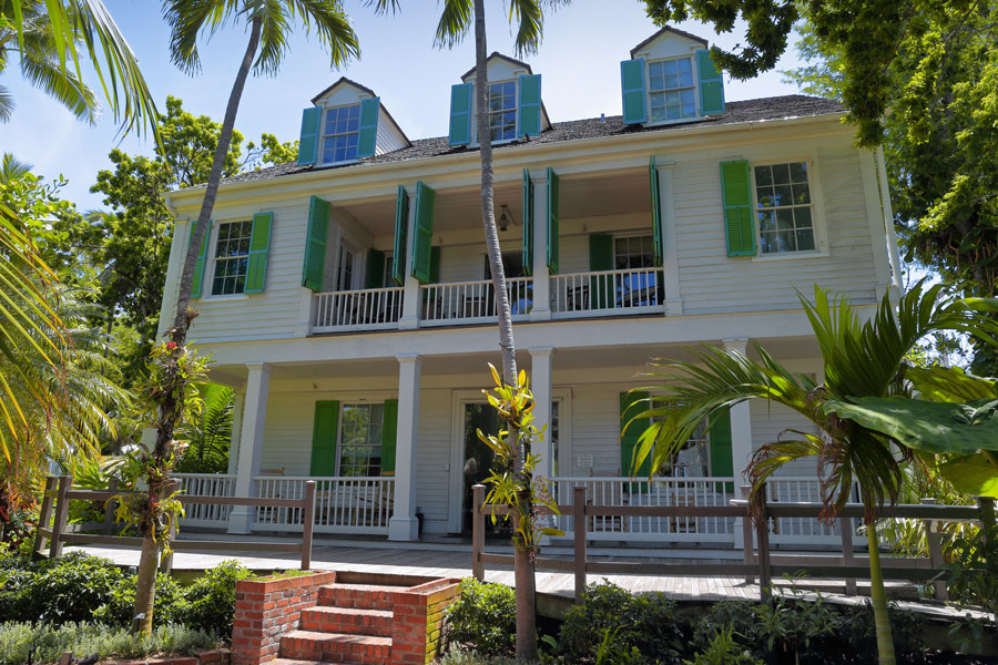 The Audubon House and Tropical Gardens offers visitors a chance to revisit life in Key West in the mid-19th century. Key West, Florida - July 19, 2018.