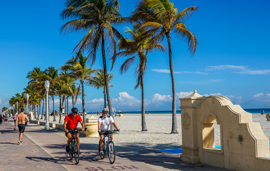 Bicycle riders and pedestrians in Broward County at the Hollywood Beach Boardwalk in South Florida, January 29, 2020.