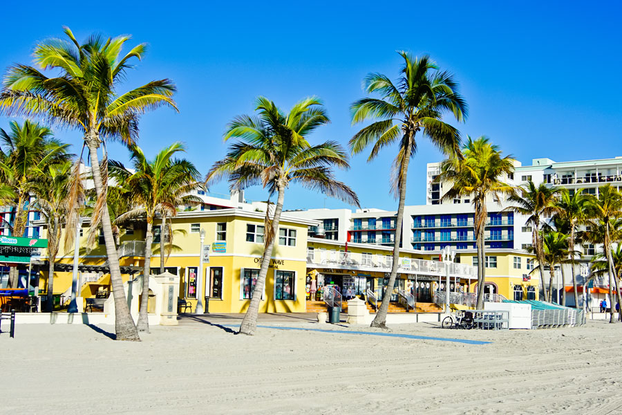 View of shops and hotels along the boardwalk of Hollywood Beach.