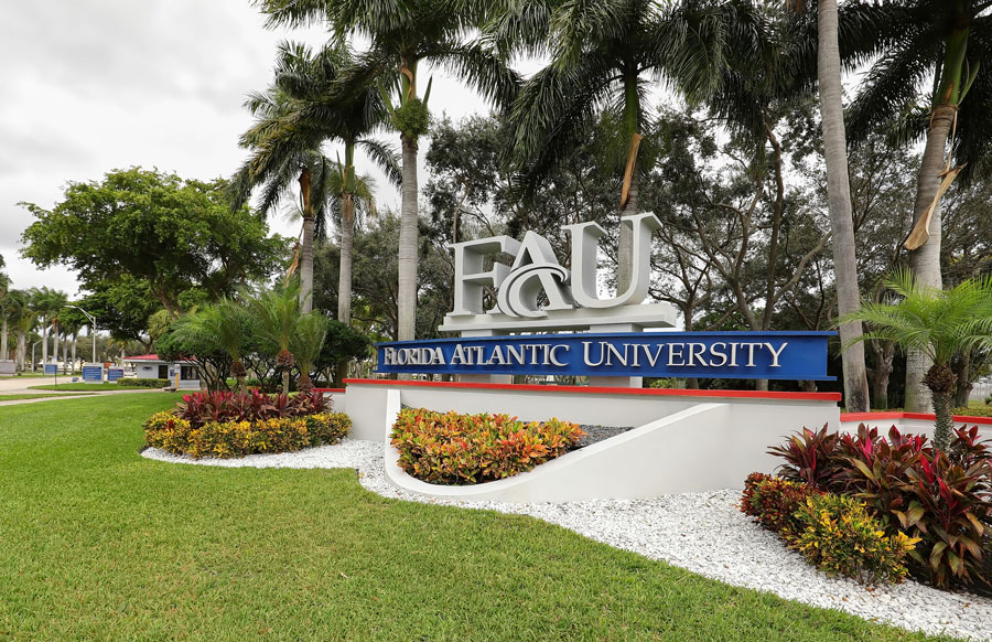 Entrance sign to Florida Atlantic University (FAU) a public university with 5 satellite campuses in the state of Florida, as seen on December 10, 2019. Editorial credit: Jillian Cain Photography / Shutterstock.com, licensed.