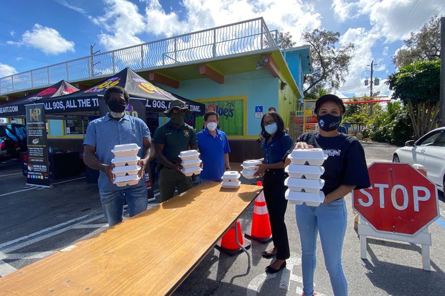 Among the volunteers were Dania Beach Broward Sheriff's Office deputies and employees who served and distributed the meals in a drive-thru pick up at Island Joe's.