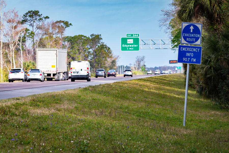 Edgewater, Florida - 16 February 2020: Emergency information sign indicates the direction of travel for those escaping Florida from a hurricane along Interstate 95.