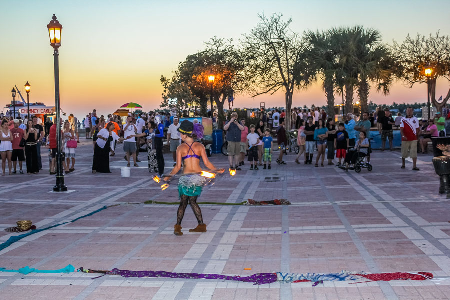 A fire eater walking on hot coals during the Sunset Celebration at Mallory Square. Shows of street artists is one of most popular attractions of Key West. Key West, Florida, April 12, 2012.