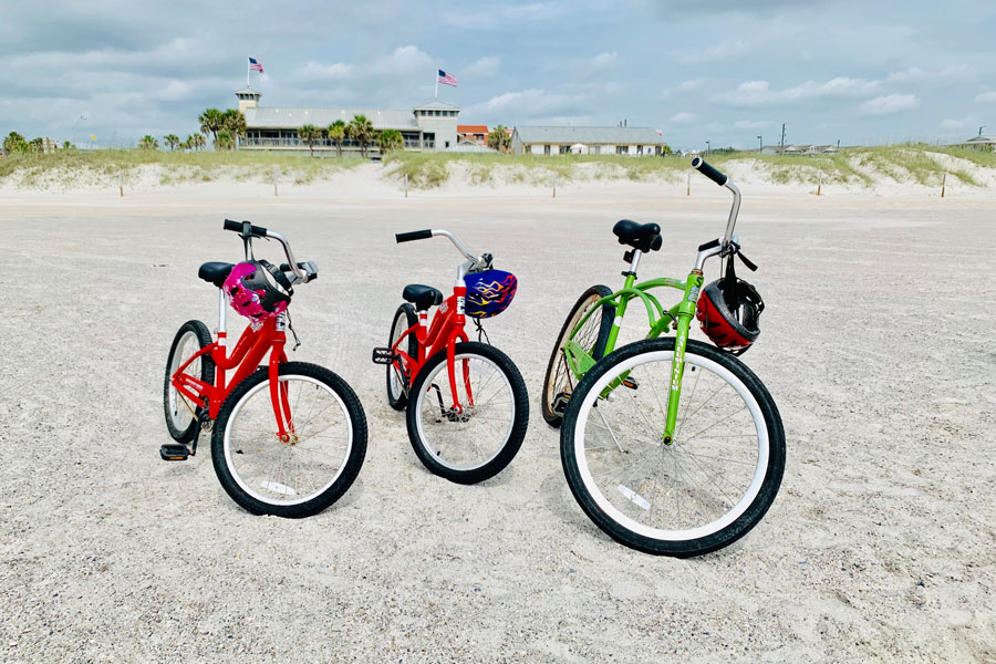 Bikes on the beach, Amelia island, Florida June 6, 2019. Editorial credit: ARYEVA / Shutterstock.com, licensed.