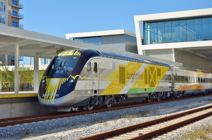 View of the Brightline train, a diesel–electric higher-speed rail system, at the West Palm Beach rail station in West Palm Beach, Florida.  Brightline has stations at Miami, Fort Lauderdale and West Palm. March 2018. Editorial credit: EQRoy / Shutterstock.com, licensed.