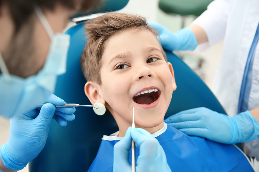 During National Children's Dental Health Month, dentists remind folks how important it is to keep a regular preventive care schedule, but recommend avoiding non-emergency care wherever community spread of the coronavirus is high or uncontrolled.
