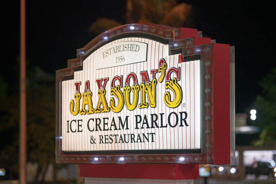 Night photo of Jaxsons Ice Cream Parlor Dania Beach, FL. Huge ice cream scoops & American fare are served at this old-fashioned parlor with memorabilia.