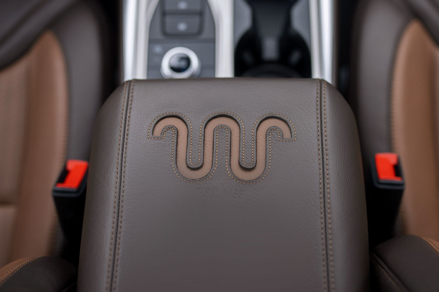 The center console is crafted with a Mesa Del Rio leather armrest and King Ranch logo insert, along with leather door trim rollovers, genuine Sapele wood instrument panel appliqués, plus leather-wrapped steering wheel with Norias stitching and a Sapele wood insert.