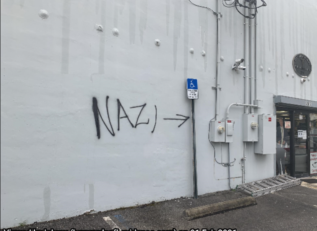 """An employee arrived at the business and observed the outer walls with the words """"NAZI"""" and """"CONVICT TRUMP"""" written in black spray paint. In addition to the words, the employee also observed the symbol of a swastika spray painted in black as well on the wall."""