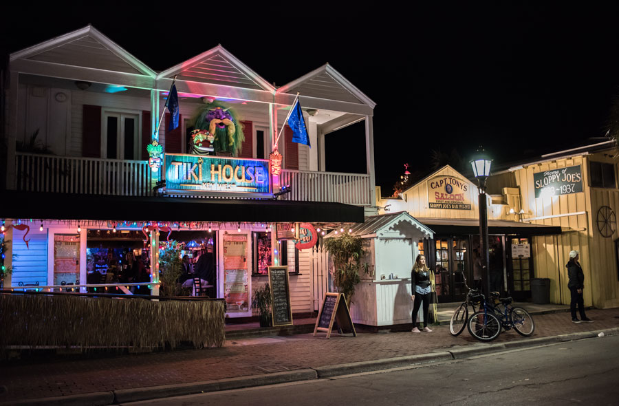 A Duval Street scene at night in the Key West part of Florida. Duval Street is a popular part of Key West for tourists. Key West, Florida.