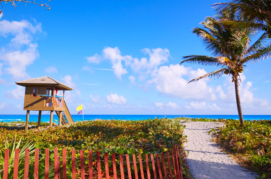 Tropical blue green waters off a Delray beach near a swimmers watchtower. Photo credit ShutterStock.com, licensed.