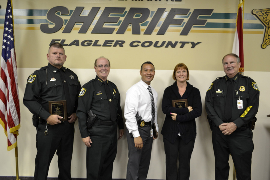 Detective Mark Moy (center) in 2013 when he was recognized as one of the Sheriff's top employees. Tuesday, Oct. 22, 2013 7 Years Ago.
