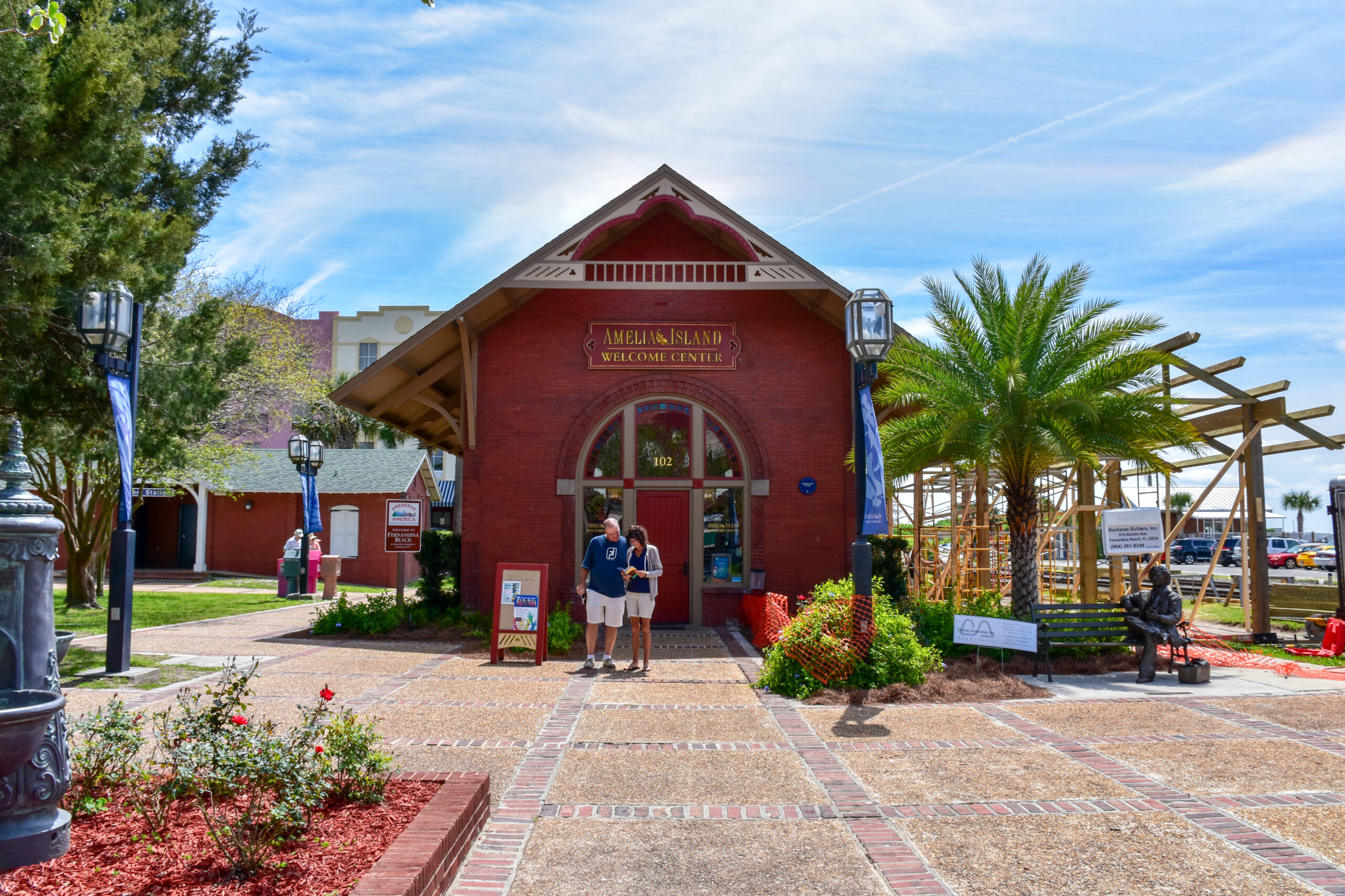 A couple standing in front of the Welcome Center at Amelia Island, Florida, set off to explore the town. Editorial credit: Joanne Dale / Shutterstock.com, licensed.
