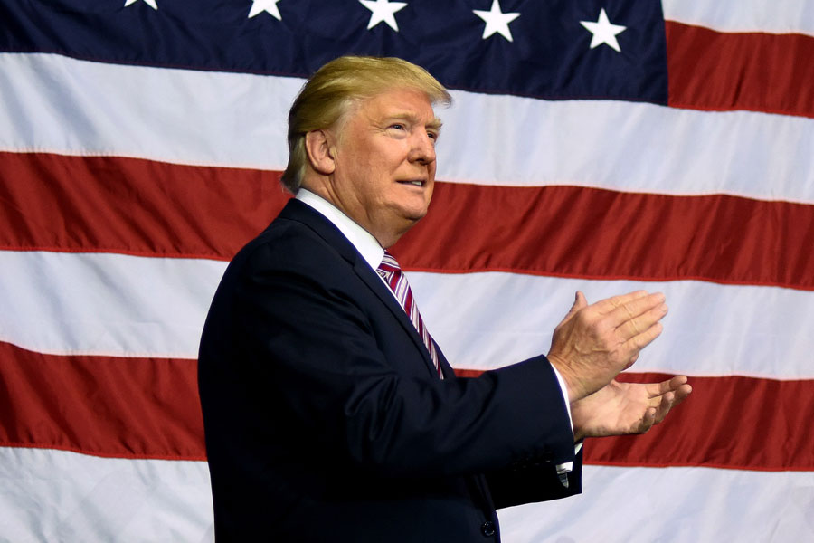 Former US President Donald Trump walks through onto the stage in front of a crowd.  November 5, 2020. Washington, DC, Editorial credit: Christos S / Shutterstock.com, licensed.