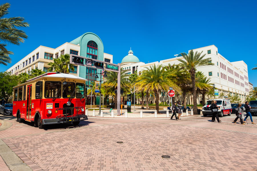 Cityscape view of the the popular West Palm Beach downtown district with City Hall along Clematis Street. West Palm Beach, Florida - March 14, 2018. Editorial credit: Fotoluminate LLC / Shutterstock.com, licensed.