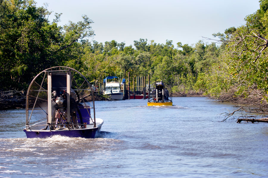 Airboats ride the River near Everglades City, Florida. Photo credit ShutterStock.com, licensed.