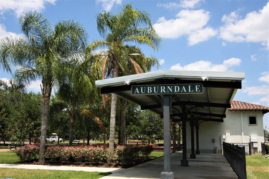 Auburndale Florida's palm trees and historic train station in its central City Park.