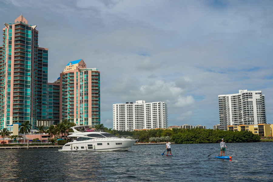 Boats and luxury condominiums in Aventura, Miami, Florida. View from Intracoastal Waterway. January 2, 2021.