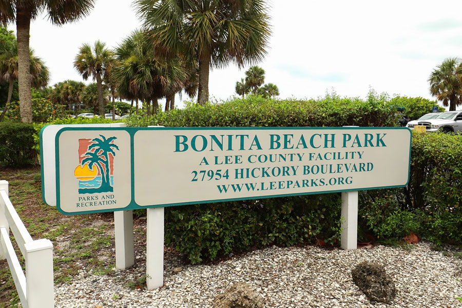 Bonita Beach Park sign, the public park is located between Fort Myers Beach and Bonita Springs, a 2.5 acre beachfront park as seen on July 21, 2020. Editorial credit: Jillian Cain Photography / Shutterstock.com, licensed.