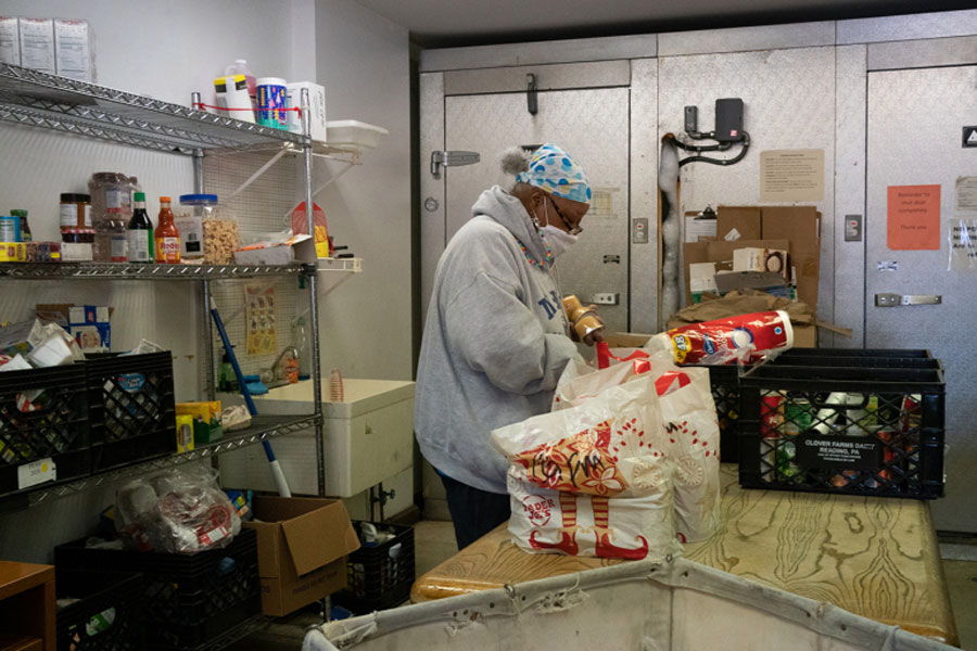 A volunteer prepares food packages for distribution at the Center for Food Action in Englewood, New Jersey, on March 9.