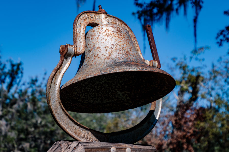 An old metal rusty bell in the park area of Arcadia Peace River Campground, Arcadia, FL. Photo credit ShutterStock.com, licensed.