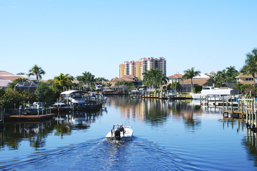 Boating along the canal in Cape Coral Florida. Photo credit ShutterStock.com, licensed.