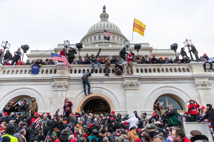 Protesters seen all over Capitol building where pro-Trump supporters riot and breached the Capitol, Washington, DC - January 6, 2021. Editorial credit: lev radin / Shutterstock.com, licensed.