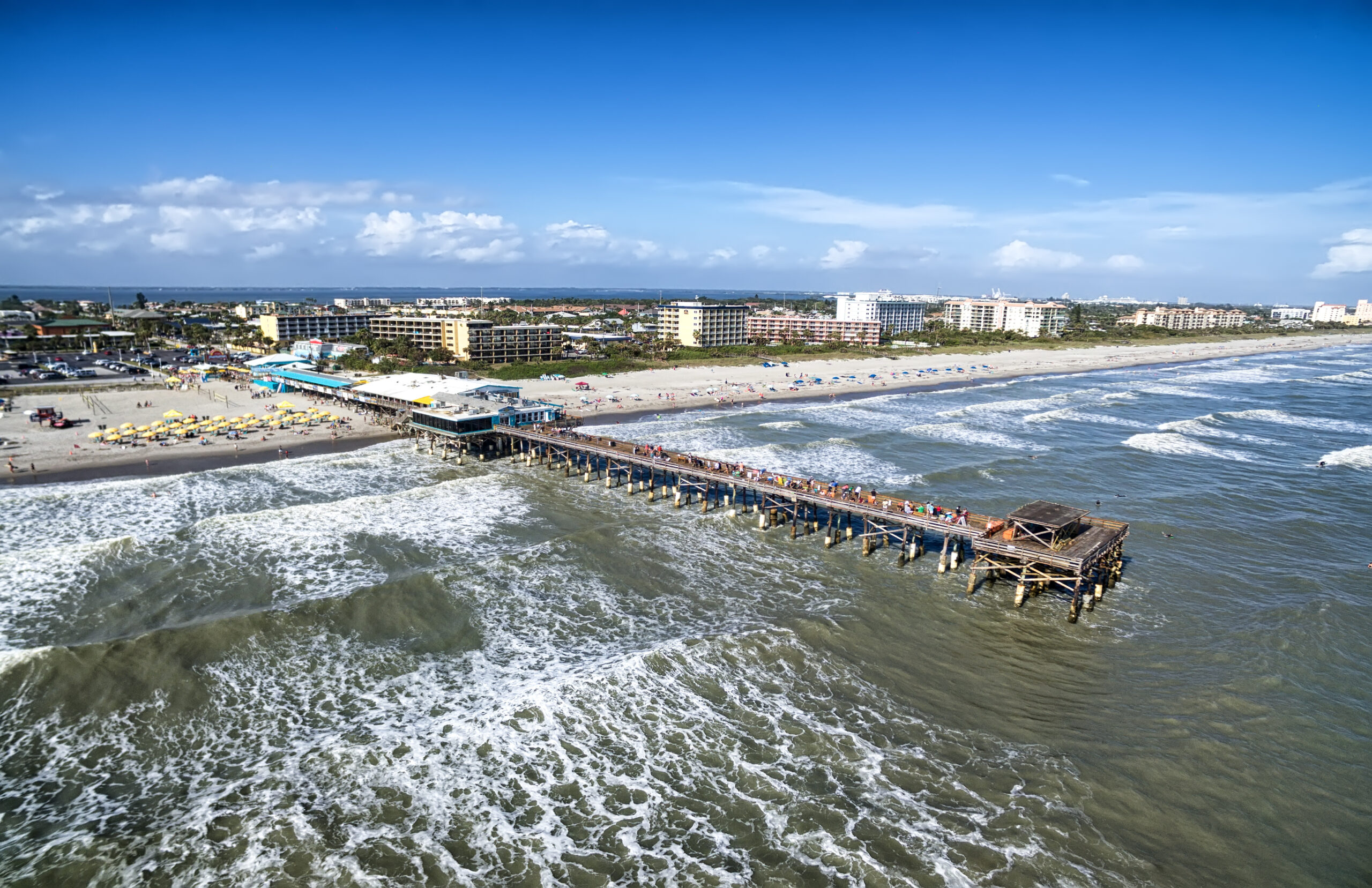 Daytime Cocoa Beach Pier aerial view, Cape Canaveral, Florida. Photo credit ShutterStock.com, licensed.