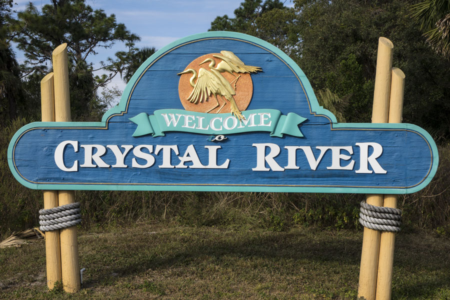 Welcome sign, Crystal River. The area is famous for the Winter migration of endangered Florida manatees. Crystal River, Florida on November 08, 2016. Photo credit: JSvideos / Shutterstock.com, licensed.