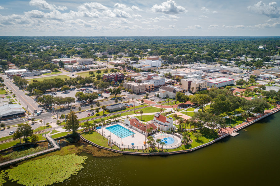 An aerial view Eustis, FL over Lake Eustis facing Ferran Park.